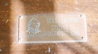 "Brass Plaque that is mounted on the top right side of the radio cabinet. Inscription reads: ""TO USS DAVENPORT from the CITIZENS OF DAVENPORT, IOWA""; Image is that of Col. Geo. Davenport, the city's namesake and founder."